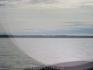 Вдалеке - большой соловецкий остров и монастырь на нем.