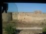 стена древней крепости,ее окружл ров ,заполненный водой
