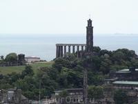 В дали маяк адмирала Нельсона и греческие колонны на окончание строительства не хватило денег