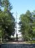 На Аллее Славы расположены памятник Павлу Батову (впереди) и обелиск с памятником моторостроителю (на заднем плане)