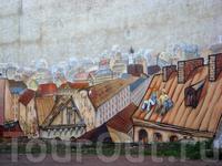 А этот шедевр на фасаде одного из разрушенных зданий создали художники из Петербурга.