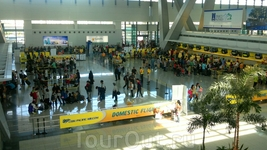 Прилетев в Манилу, я изрядно побегала по лабиринтам аэропорта в поисках своего gate...