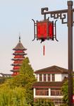 Красные фонарики - символ счастья и достатка. Они появляются на доме раньше. чем его подведут под крышу.