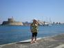 На набережной Родоса - столицы острова, напротив крепости Св.Николая. Вдалеке стоят три ветряные мельницы.