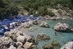 Зеленый, скалистый, компактный и уютный пляжик Энтони Куин, защищенный от ветров и с прозрачной водой, что еще нужно для счастья?..