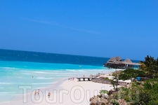 За отдыхом я отправилась на остров Занзибар, славящийся своими большими белоснежными пляжами и лазурным теплым океаном. Особо интересных достопримечательностей ...