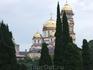 Вид сквозь кипарисы на  монастырь.