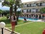 на фоне отеля  Malia Bay