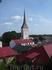 Очень я люблю такие виды: старые церкви, красные черепичные крыши=)