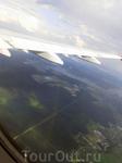 Надо сказать, что вид из самолета на подлете к Москве гораздо зеленее, а особенно впечатляет когда внизу под крылом самолета видишь радугу. Я такое видела ...