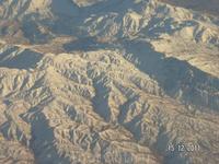 Горы с самолета, возможно Кавказ