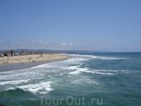 Тихий океан, пирс пляжного городка New Port