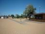 Оборудованный городской чистый пляж в Аршинцево. Ехали к нему через унылую промзону.Портальные краны на заднем плане.