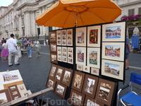 на площади Навона (как и во многих других местах) можно купить маленькие зарисовки - виды Рима.. и как я могла не купить??
