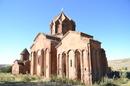 Главный храм размещен по центру и считается главным сооружением. Храм выстроен из красноватого кирпича и являет из себя купольный зал. Зонтичный купол ...