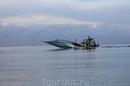 Рыбаки  куда-то спешат