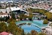 Открытка. Вид на Тбилиси от крепости Нарикала. на переднем плане пешеходный мост Мира. далее дворец юстиции