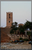 Поселок Неа-Фокиа. Вид на башню и за деревьями виднеется верхушка церкви.