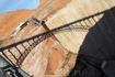 Отражение арки моста на стене плотины