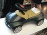 В холе на заводе BMW, машинка для детишек. Так как это фирменная машинка марки BMW, то и стоит она весьма прилично