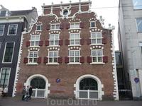 дома Амстердама.