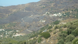а нифига!ехать и ехать. Вот черные горы.Пожар.Горели три недели.Деревню удалось спасти.