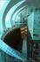 сзади лифта по тёмной изогнутой стене медленно стекает вода