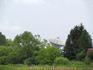 Антенна радиотелескопа РТ-64 видная из за деревьев