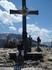 Крест-это символ покорения вершины.Изнурительное солнце,отдых небольшой.