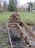 Исток искусственного ручья, оформлен каменной кладкой.