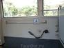 В туристическом автобусе-поручень для инвалидной коляски