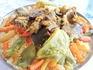 Национальное блюдо марокканцев - таджин. Кус-кус с овощами и мясом (говядиной или бараниной) и сладким соусом из нута, изюма и лука.