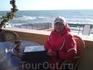 Столик у моря. Ветренно , прохладно не по весеннему , но очень солнечно!!    На заднем плане по морю катит серфингист.