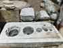 """Эта толстая мраморная плита с отверстиями под бронзовые сосуды служила своеобразной """"системой мер и весов"""" для контроля за жидкими товарами."""