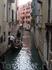 по каналам Венеции, ещё и ногой помогает...