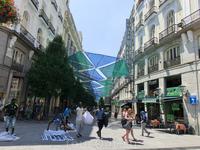Еще одна улица с тентами Calle de Arenal, она ведет от Puerta del Sol к Королевской Опере.