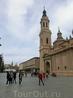 Если смотреть влево от собора, то в другом конце площади виднеется фонтан Hispanidad и церковь Iglesia de San Juan de los Panetes.  Я знала, что в одной ...