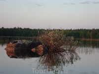 Камень в озере.