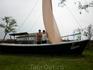 Лодка с парусом. Ловля рыбы неотъемлемая часть быта казаков.