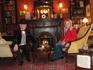 С доктором Ватсоном, сидя в кресле Шерлока Холмса