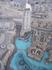 Вот те темные окружности на голубом фоне - знаменитые танцующие фонтаны. Так они смотрятся со 124 этажа.
