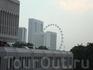 вид из окна отеля Peninsula Excelsior на Singapore Flyer