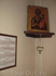 """""""Святой уголок"""" с иконой и молитвами рядом с ней."""