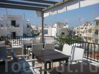 Ресторан Synthesis на площиди Диагорас в городе Кос, с террасой и замечательной кухней в стиле средиземноморского fusion