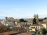 Вид на город. Справа - башенки ворот Бисагра, слева - церковь Сантьяго-дель-Аррабаль.