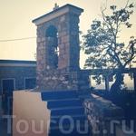 колокольня при церкви в деревне Зий