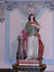 Фигура Святой Барбары (Варвары). Немного об этой святой. Святая Варвара жила в III веке в городе Илиополе Финикийском. Её отец — Диоскур (Диоскор) — был язычником и представителем аристократии в Малой