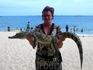 """рядом с кафе """"СССР"""" на берегу сидит китаец и всех желающих приглашает сфотографироваться с маленьким крокодильчиком или с большим питоном:))). Я выбрала ..."""
