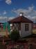 А на этой площадке построены детские домики: жилой дом, почта...