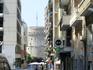 Идем к центру по улице Цемиски. В просветах боковых улочек видна Белая башня - символ города Салоники.